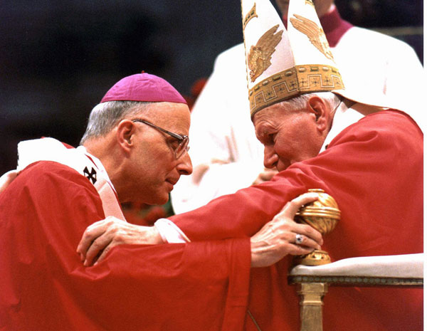 Monsignor Francis Eugene George, Archbishop of Chicago, Ill. , receives the pallium from Pope John Paul II during an ancient rite in St. Peter&#39;s Basilica at the Vatican, Sunday, June 29, 1997. The pallium, a band of white wool decorated with black crosses, sumbolizes the archbishops&#39; bond to the Vatican. <span class=meta>( AP Photo&#47;Arturo Mari)</span>